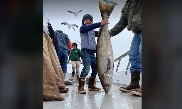 Benjamin Morrison, aged 5, has caught an enormous 42-pound seabass all on his own